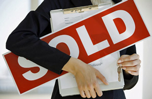 sold-sign-held-in-arms