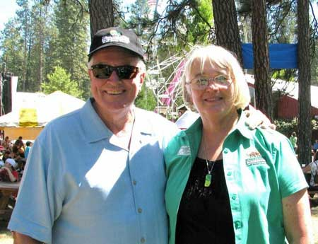 "Huell Howser, founder and host of the PBS program California's Gold, takes a moment to interview Sandy Woods, CEO of the Nevada County Fairgrounds. Howser visited the Nevada County Fair on Thursday to film an episode for a PBS series he is developing on ""California's Golden Fairs."""