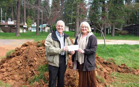 Ed Scofield, President of the Nevada County Fairgrounds Foundation, presents a $30,000 check to Fairgrounds CEO Sandy Woods.  With the elimination of state funding to the Fairgrounds, the Foundation plays an increasingly critical role in supporting the Fairgrounds, especially with infrastructure projects.