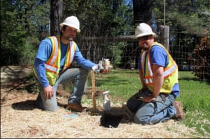 NID employees Chad Garvey, left, and Andrew Browning prepare to install a new water meter along Rattlesnake Road near Grass Valley