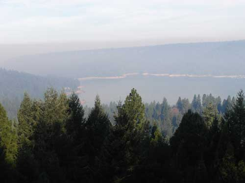 Smoke over Scotts Flat Lake August 12, 2013. Picture taken by John O'Dell from my deck.